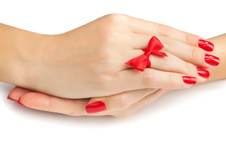 Relaxing Hands with red manicure isolated photo