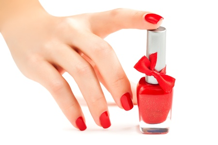 Hands with red manicure isolated photo