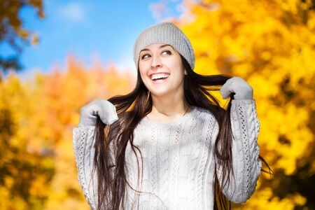 cute cheerful girl on a background of autumn trees photo