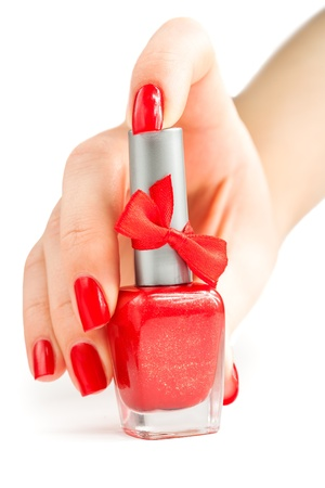 Hand with red manicure and nail polish  isolated photo