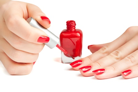 manicure  applying nail polish  isolated photo