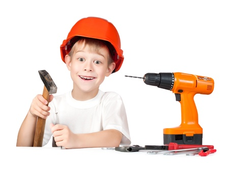 cute little boy with hammer and screwdriver photo