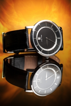 watches with a leather strap on a flame background photo