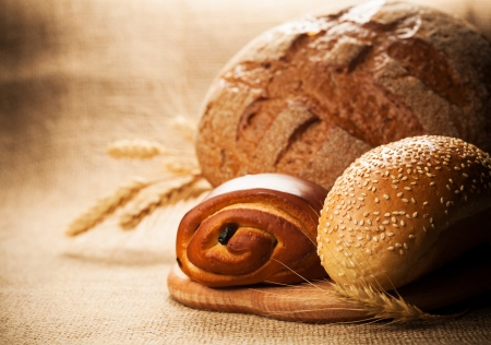 rye bread and pastries on burlap background