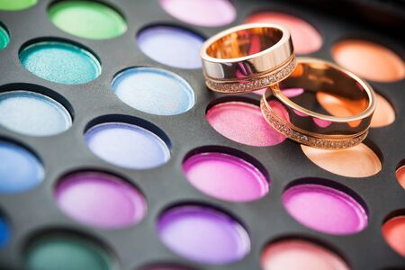 makeup kit for eyes and wedding rings photo