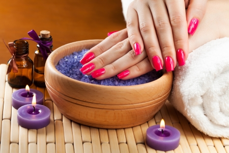 female hands with aromatic candles and towel  Spa photo