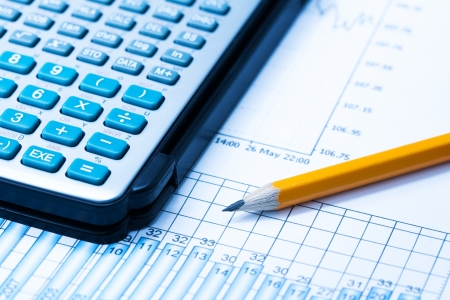 finance Statistical graphs and calculator photo