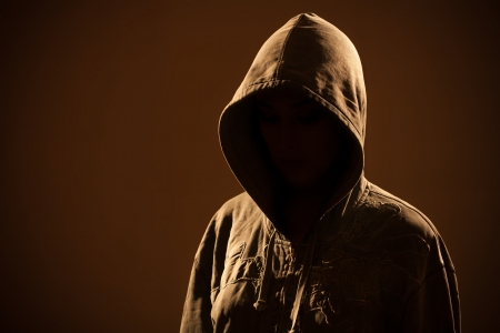 Scary woman with hood in darkness Stock Photo - 18086316
