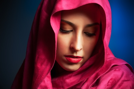 femenine: beautiful young woman with red veil around her face