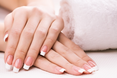 nail spa: female hands with towel  Spa Stock Photo