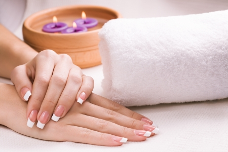 hand towel: female hands with aromatic candles and towel  Spa