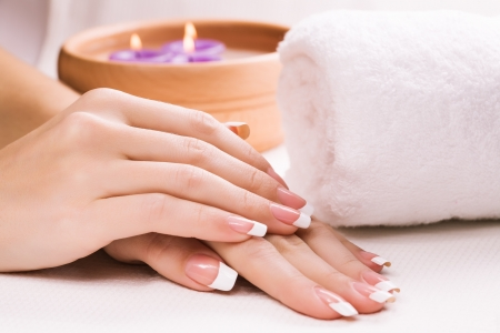 female hands with aromatic candles and towel  Spa