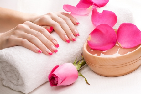 hands with fragrant rose petals and towel