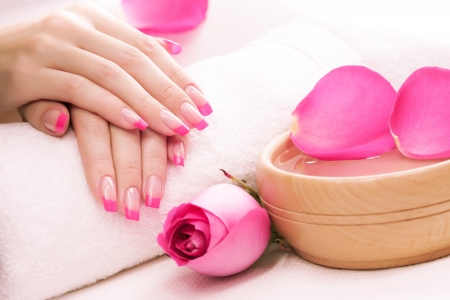 hands with rose petals and towel  Spa