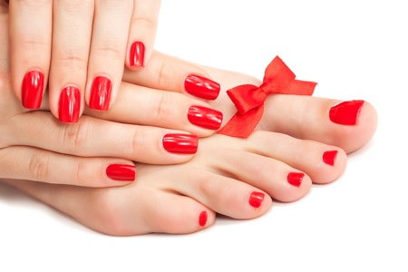 Red manicure and pedicure with a bow Stock Photo