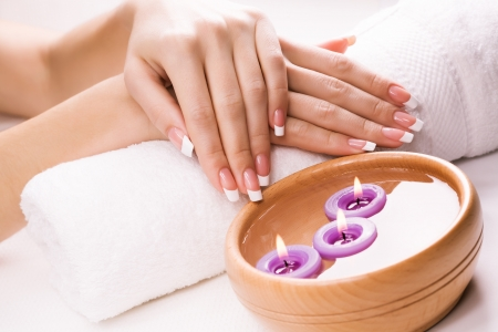 female hands with aromatic candles and towel Stock Photo - 18594231