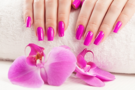 nail care: beautyful manicure with fragrant orchid and towel  Stock Photo