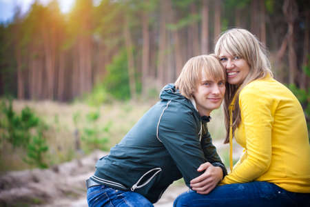 loving couple are sitting in the sunny park photo