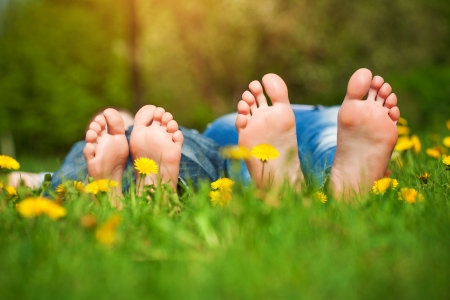 pretty feet: feet on grass  Family picnic in spring park Stock Photo