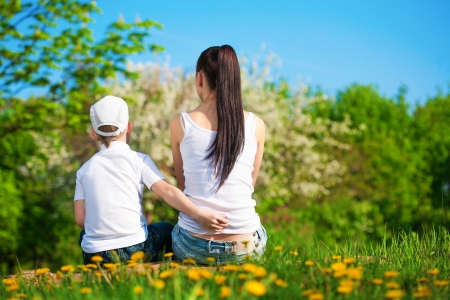 mother and son are resting in the park  picnic photo
