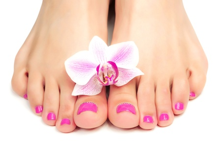 pink pedicure with a orchid flower