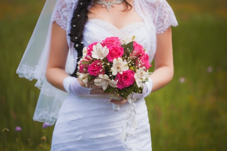 A bridal bouquet held by the bride photo