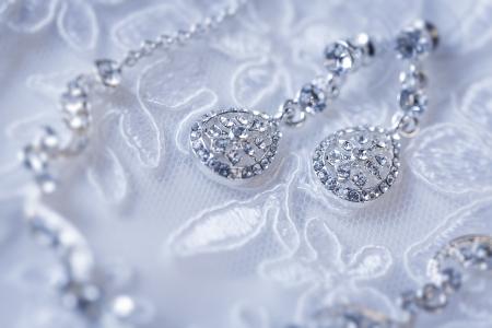 jewelry on a white wedding dress Stock Photo