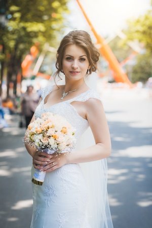happy beautiful bride  in the park photo