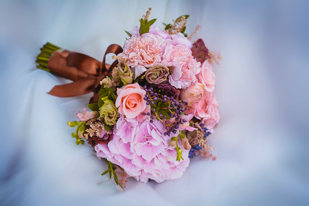 bridal bouquet: wedding bouquet of flowers and wedding dress