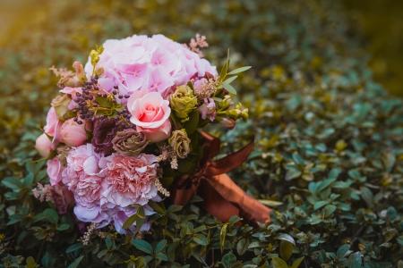 beautiful wedding flowers bouquet on the green grass