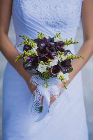 bridal bouquet  in the the brides hands Stock Photo