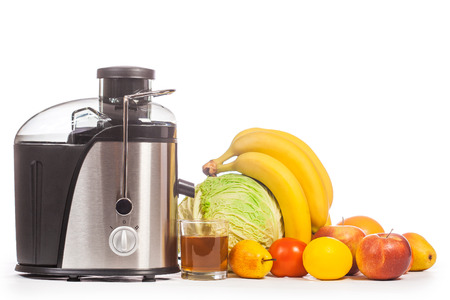 juicer with fruit on a white
