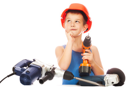 assistant engineer: boy in a helmet with electric hammer