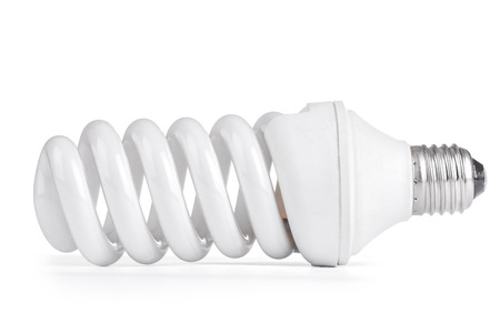 kilowatt: White energy saving lamp on white background.