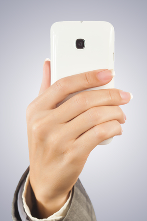 back screen: Hand holding smart phone with Stock Photo