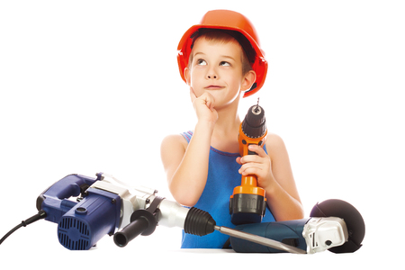 little boy in a helmet with electric tools photo