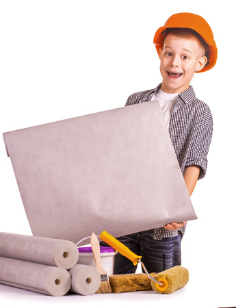 funny boy with a roll of wallpaper and brush photo