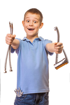 boy plumber with faucet on a white background photo
