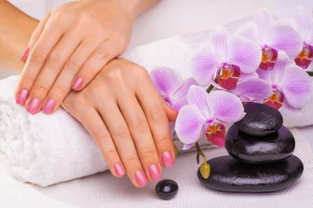 beautiful manicure with pink orchid