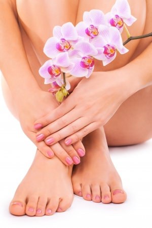 manicure and pedicure: beautiful manicure and pedicure on the white Stock Photo