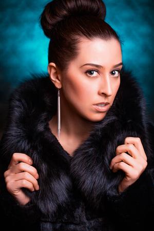 Beautiful Woman in Luxury Fur Coat photo