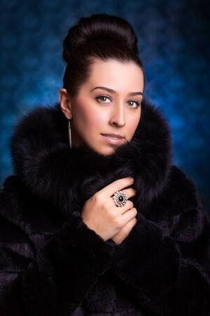blue grey coat: Beautiful Woman in Luxury Fur Coat Stock Photo