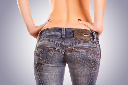 blue jeans: sexy woman bodyin blue jeans Stock Photo