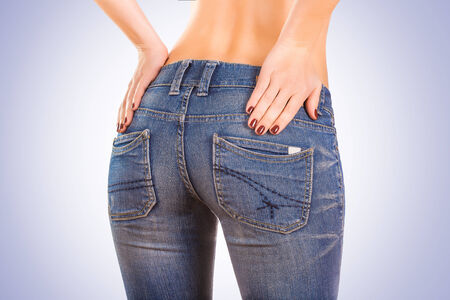 hither: sexy woman bodyin blue jeans Stock Photo