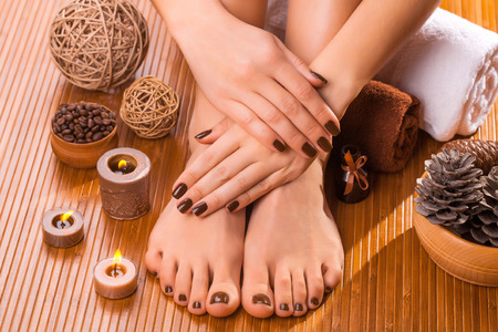 beautiful brown manicure and pedicure Stock Photo