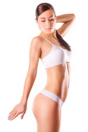 sexy body: Cute Girl athlete on a white background Stock Photo