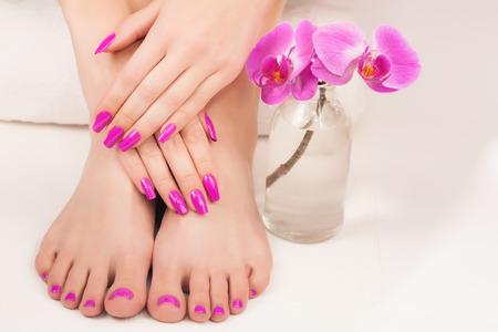 beautiful manicure and pedicure on the white Standard-Bild