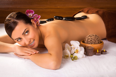 beautiful brunette in a massage parlor. spa photo