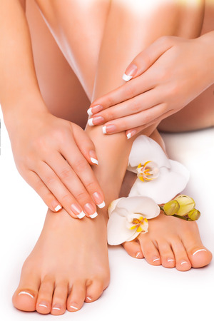 beautiful french manicure and pedicure  with white orchidand Stock Photo