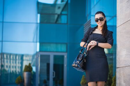 attractive  female: Business woman walking outside in city. office worker Stock Photo